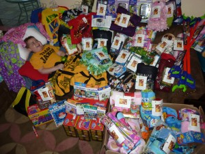 Jaxon covered in welcome gifts we assembled for Proton warriors