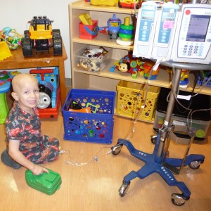 Enjoying a break from chemo in the hospital playroom